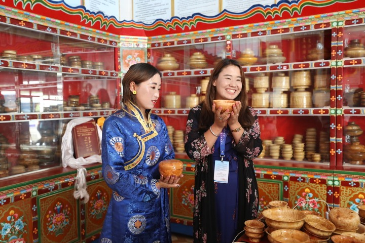 Traditional wooden bowls help lift Tibetan village out of poverty